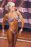 Female bikini fitness contestant shows her best side Stock Photography