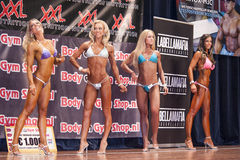 Female bikini fitness contestants showing their best in a lineup Stock Photography