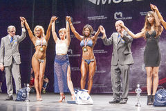 Female bikini fitness model Evelyn Dirocie celebrates her victor Stock Images
