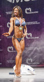 Female bikini fitness model Evelyn Dirocie shows her best front Royalty Free Stock Photos