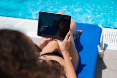 Female in bikini holding digital tablet with blank copy space screen for your advertising content Stock Photos