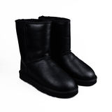 Female black boots Royalty Free Stock Image