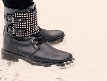 Female black boots on snow Stock Images