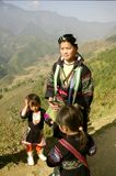 Female black and ethnic Hmong with childrens. Woman of the Black Hmong with her children beside the road Stock Images