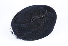 Female black hat with a veil isolated on a white background Royalty Free Stock Photography
