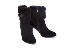 Female black leather ankle boots Royalty Free Stock Photography
