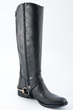 Female black leather boots with low heels. 