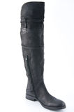 Female black leather boots with low heels. Stock Photo