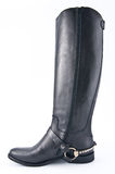 Female black leather boots with low heels. Stock Photos