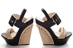 Female black platform shoes with beige inserts and studs Stock Photos