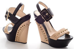 Female black platform shoes with beige inserts and studs Royalty Free Stock Image