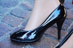 Female black shoe on the pavement Royalty Free Stock Image