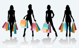 Female black silhouette with shopping bags. Fashion shopping woman black silhouette with shopping bags. Sale advertising template - vector illustration Stock Photos