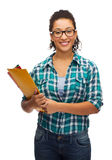 Female black student in eyeglasses with folders. Education and people concept - smiling female african american student in eyeglasses with folders Stock Photo