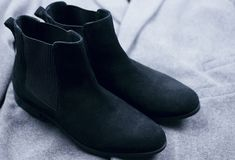Female black suede chelsee shoes Stock Image