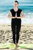 Female in black T-shirt is staying and practicing meditation Royalty Free Stock Photo