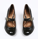 Female black varnished shoes Stock Image