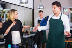 Female blaming hairdresser in bad haircut Royalty Free Stock Image