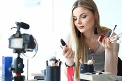 Female Blogger Makeup Beauty Vlog Creator Job. Young Woman Recording Video Blog, Promoting Cosmetic Product Recording Process on Camera. Caucasian Vlogger Girl royalty free stock photography