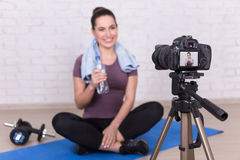 Female blogger making new video about sport at home Royalty Free Stock Images