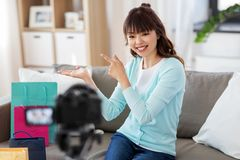 Female blogger making video blog about shopping stock image
