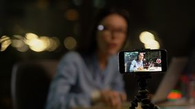 Female blogger shooting video, training or product review, making money online. Stock footage stock video