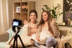 Female bloggers with camera recording home video royalty free stock photo