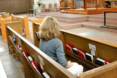 Female blond beauty in church. stock images