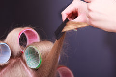 Female blond hair head curlers rollers hairdresser beauty salon Royalty Free Stock Photography