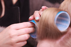 Female blond hair head curlers rollers hairdresser beauty salon Stock Photo