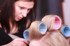 Female blond hair head curlers rollers hairdresser beauty salon Royalty Free Stock Photos