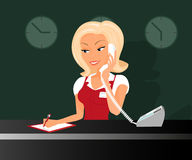 Female blond receptioonist is taking a call in the Royalty Free Stock Photo