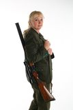 Female blonde huntress going hunting Stock Photo