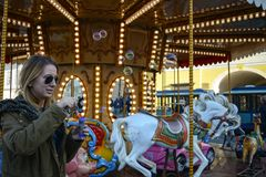Soap Bubbles. A female blonde model blowing soap bubbles at a merry-go-round Royalty Free Stock Photos