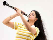 Female blowing clarinet Royalty Free Stock Image