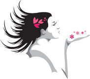 Female Blowing Flowers Stock Photo