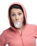 Female blows out pink bubble gum Royalty Free Stock Image