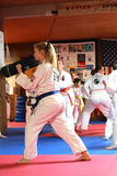 Female blue belt tests for promotion in Cedar Rapids, Iowa. Stock Photo