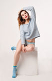 Female in blue blousen, pantie and socks Stock Images