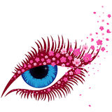 Female blue eye with small pink sakura flowers Stock Photography