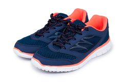 Female blue sport shoes isolated on white background royalty free stock image