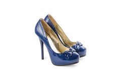 Female blue varnished shoes with high heels Stock Images
