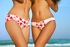 Female bodies in pants with hearts Royalty Free Stock Image