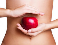 Female body with apple Stock Photos