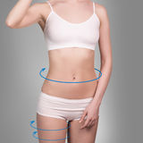 Female body with the blue arrows. Healthy nutrition, liposuction, sport and cellulite removal concept Stock Photo