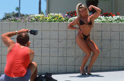 A female body builder flexing for the camera, Stock Photos