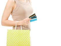 The female body with credit cards and shopping. Stock Photo