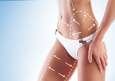 Female body with the drawing arrows on it Royalty Free Stock Photo