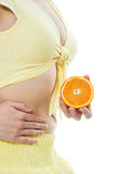 The female body and a fruit Royalty Free Stock Image