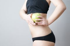 Female body with green apple Royalty Free Stock Images